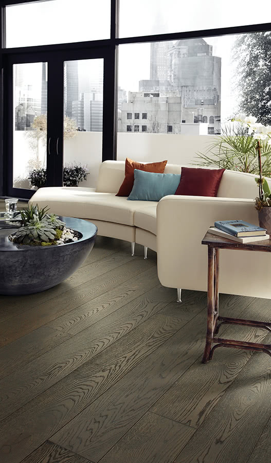 <a data-cke-saved-href='/hardwood/flooring/invincible_hardwood/' href='/hardwood/flooring/invincible_hardwood/'>Invincible Hardwood</a> is used to give this living room a touch of weathered elegance. Choose from a variety of colors and finishes to complete this clean, urban interior.