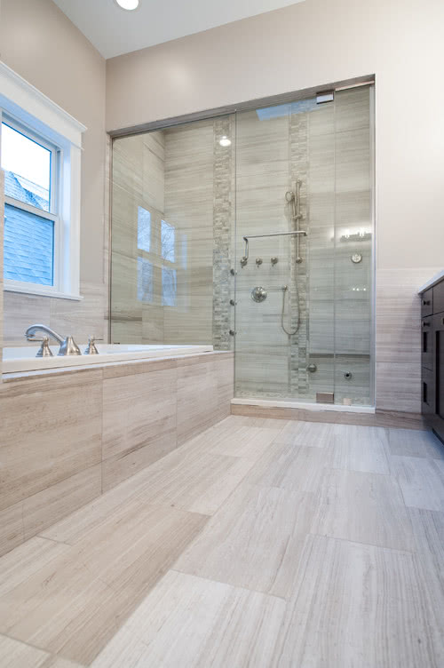 Whit Oak Honed Marble Bathroom: Home Carpet One's Meaghan Leavy designed this contemporary master bathroom for a new construction house featuring in-stock White Oak Honed Marble with Argent limestone accents. Photography by Maricel Cruz.