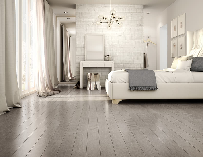 Love hardwood floors but still want a clean and light look? <a data-cke-saved-href='/hardwood/flooring/preverco/' href='/hardwood/flooring/preverco/' target='_blank'>Preverco's</a> Yellow Birch hardwood in Inox is a perfect balance of classic and contemporary. This room uses Courchevel color on the walls to perfectly compliment the cool tones in the flooring and decor.