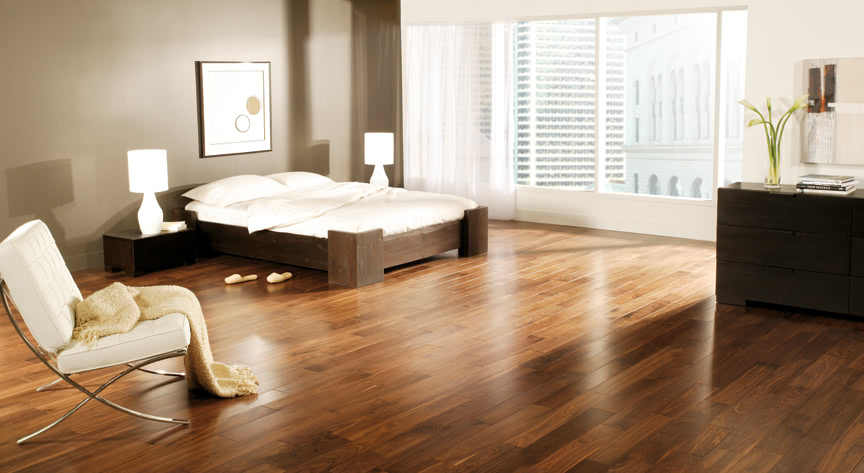 This bedroom's sleek and minimalist approach brings in a bit of warmth with these Walnut Nuance Appearance hardwood floors from <a data-cke-saved-href='/hardwood/flooring/preverco/' href='/hardwood/flooring/preverco/' target='_blank'>Preverco.</a>
