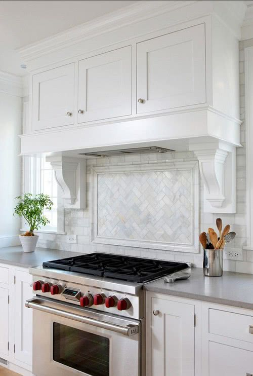 This kitchen features a new beautiful modern natural stone tile called Arabescato. This tile imitates the hottest selling stone looks. The tile can be found exclusively at Home Carpet One.