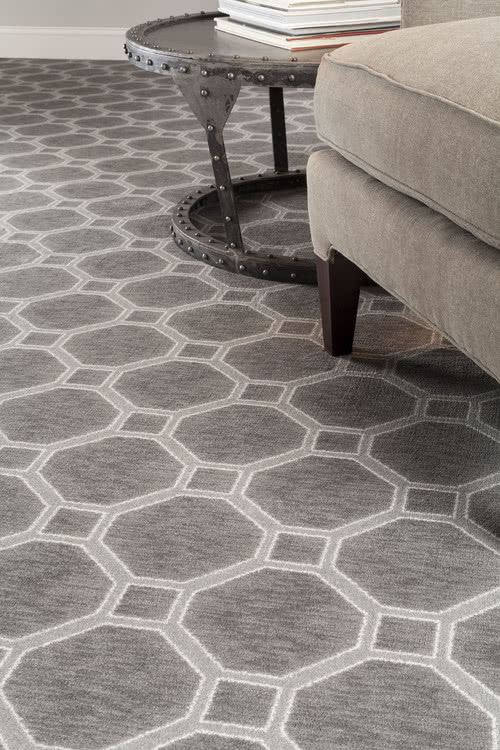 Large scale patterned carpets have made a big comeback. This piece from Milliken adds personality to the room.