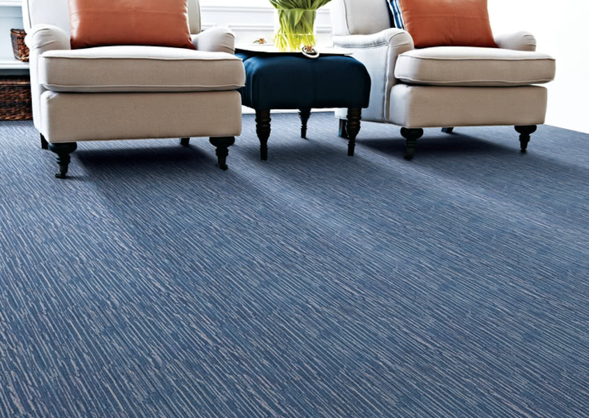 Stanton 'Santino' carpet (featured in Indigo) is a made from hand tufted wool with the beauty and striations of a handmade rug, installed wall to wall.