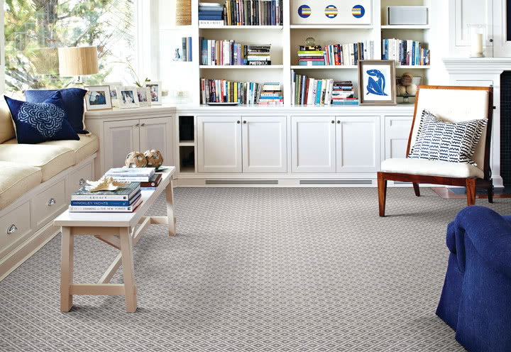 This patterned wool - wilton, <a data-cke-saved-href='https://homecarpetone.com/shop/item/axc/2359/AXIS' href='https://homecarpetone.com/shop/item/axc/2359/AXIS' target='_blank'>Axis carpet from Stanton</a> adds texture and warmth to a bright and inviting living room.