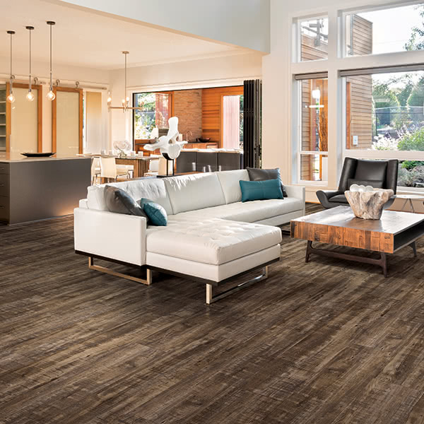 TA dark walnut vinyl floor in plank, like this Masland in 'River Oak', can create an elegant backdrop that matches the sophisticated choices you've made in your home.