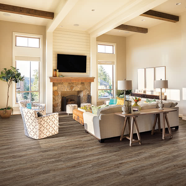 We love how this brown, rustic-looking vinyl Dixie flooring in 'Vintage Oak' pairs with chic décor.