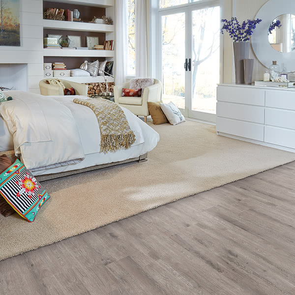 Planning to revamp your bedroom? This soft taupe STAINMASTER® PetProtect™ luxury vinyl flooring in 'Deep Cloud' will help you feel relaxed and comfortable.