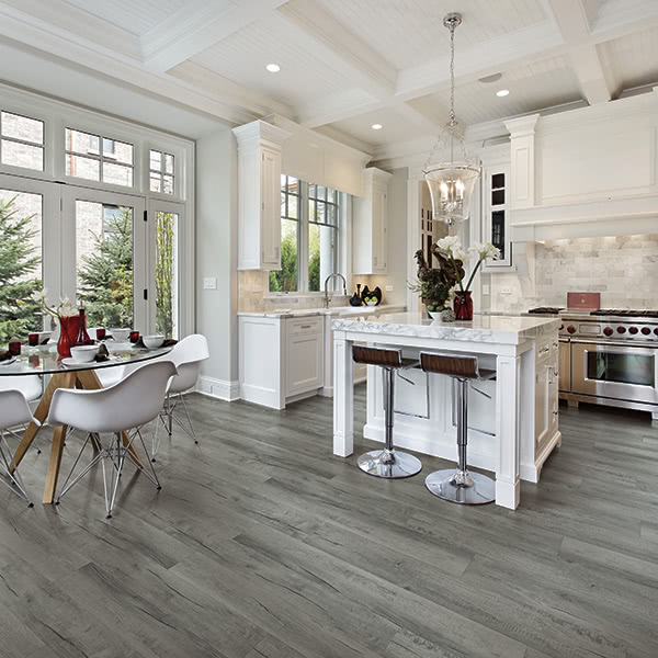This kitchen uses Dixie Vinyl Flooring, an Exposed Oak style from STAINMASTER®.