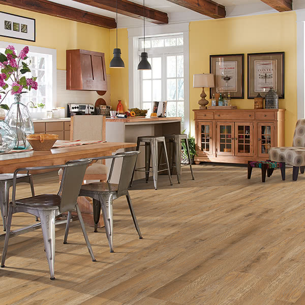 Bring unity to open floorplans with stylish luxury vinyl flooring like these barnwood inspired Phenix planks in 'Toasted Brown'.