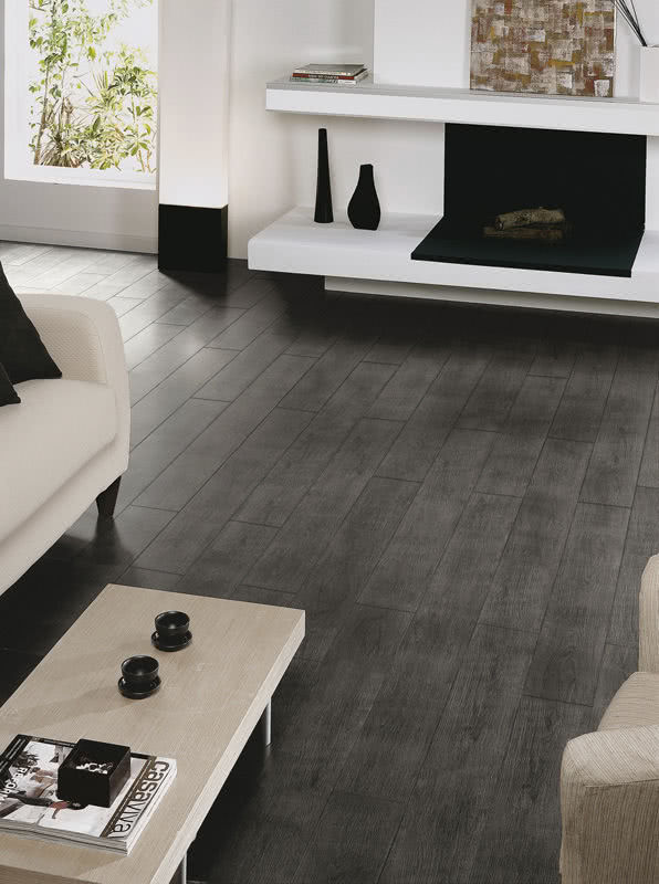 A more contemporary approach to the wood-look, <a data-cke-saved-href='/shop/item/forestt/94/Forest_Tile' href='/shop/item/forestt/94/Forest_Tile' target='_blank'>Forest porcelain tiles</a> mimic a dark grey stain providing an edgy and refined floor.