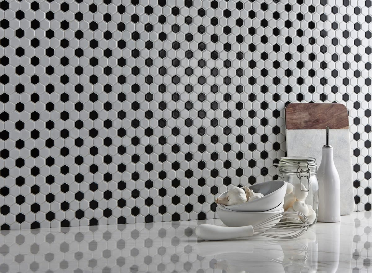 This <a data-cke-saved-href='/shop/item/hexmos/83/Hexagon_Mosaic_Tile' href='/shop/item/hexmos/83/Hexagon_Mosaic_Tile' target='_blank'>Hexagon Mosaic</a> is perfect for both an elegant all-white look, or a bold retro black and white combination. Choose from 1x1 or 2x2 hexagons to make your wall, backsplash or floor a true accent.