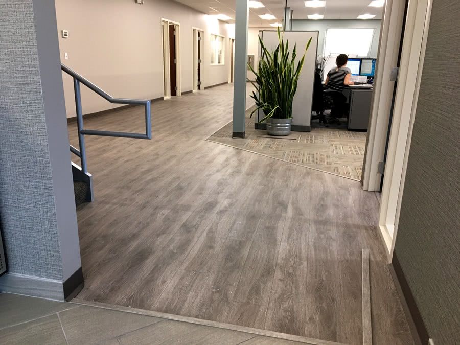 Vinyl has a much longer lifespan and holds up ubetter under foot traffic than carpet, making it an ideal solution for commercial facilities and offices.